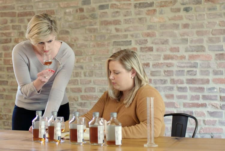 Two of the Two Worlds Whiskey Team Sampling Bourbons to Create a Blend